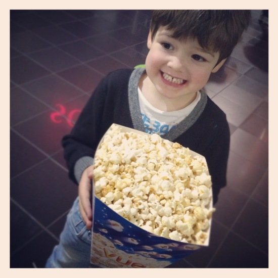 Joshua with popcorn.JPG