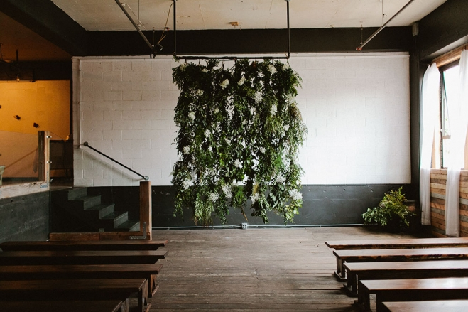 Floral wedding backdrop Installation by  photo by  Jamie Jones