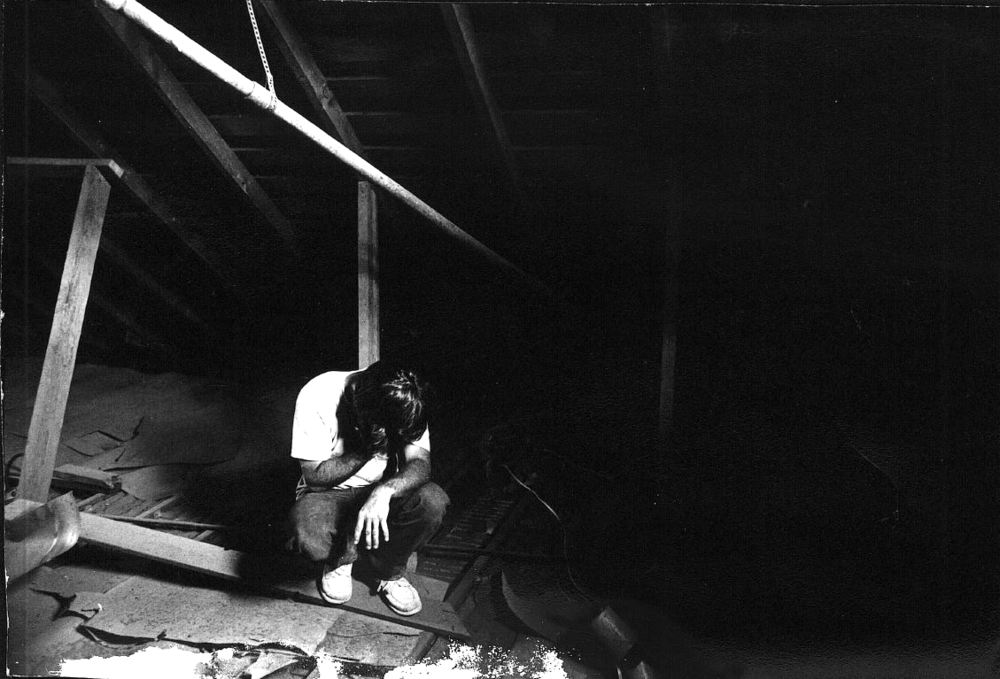 Tom Cella in the attic of one of the first jobs Spectrum had.