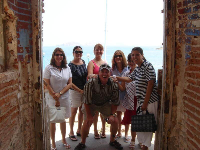 Owners Conchita + Chris with some of her sisters standing at the entrance. (from left) Conchita, Marina, Lupita, Lety, sister-in-law Alma, Chayito, + Chris.