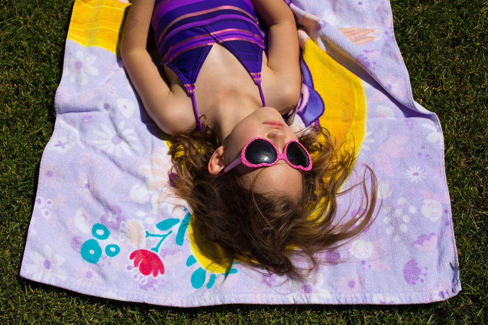Girl sunbathing with sunglasses