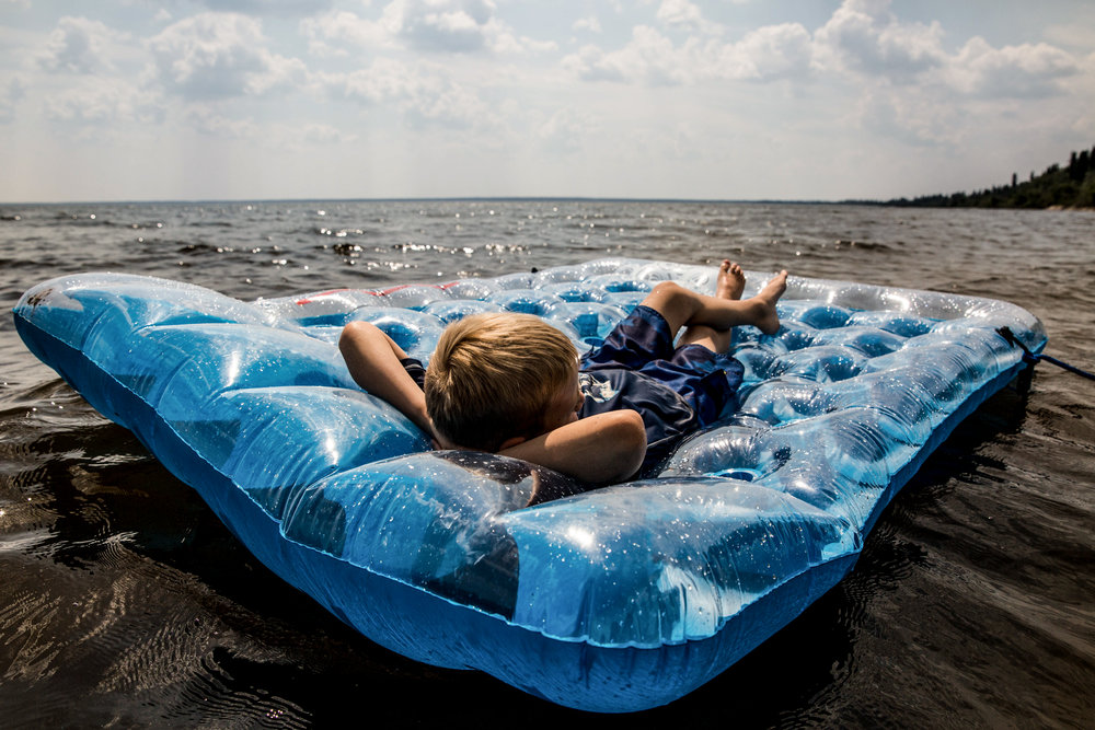 Boy floating on water