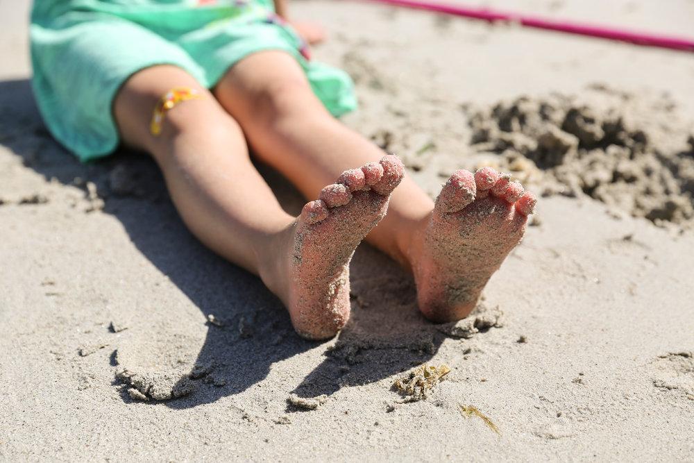 sandy kid toes on beach