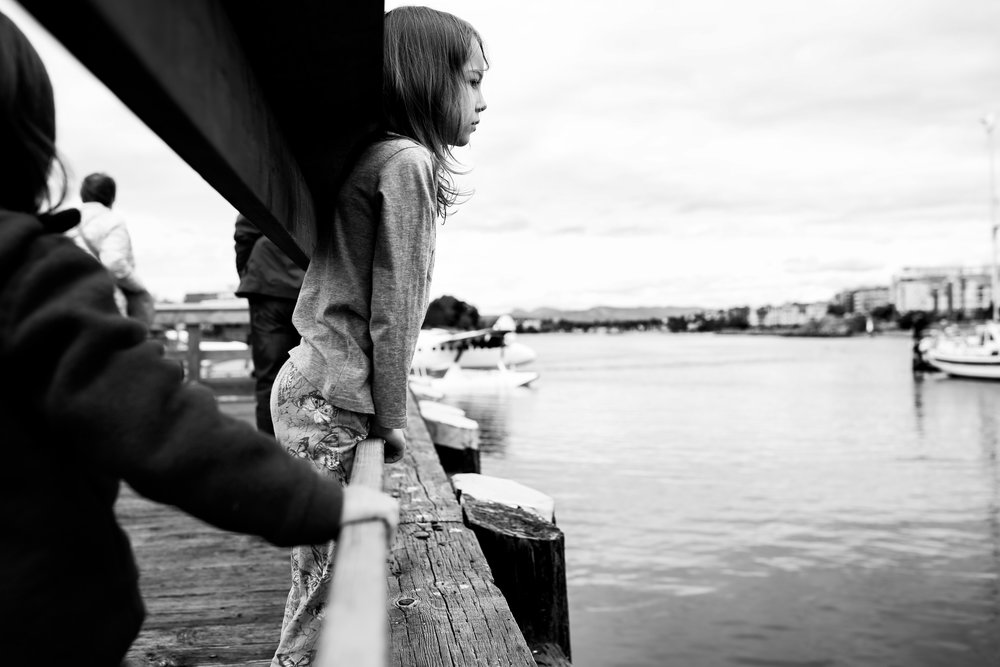young girl looking out over harbour