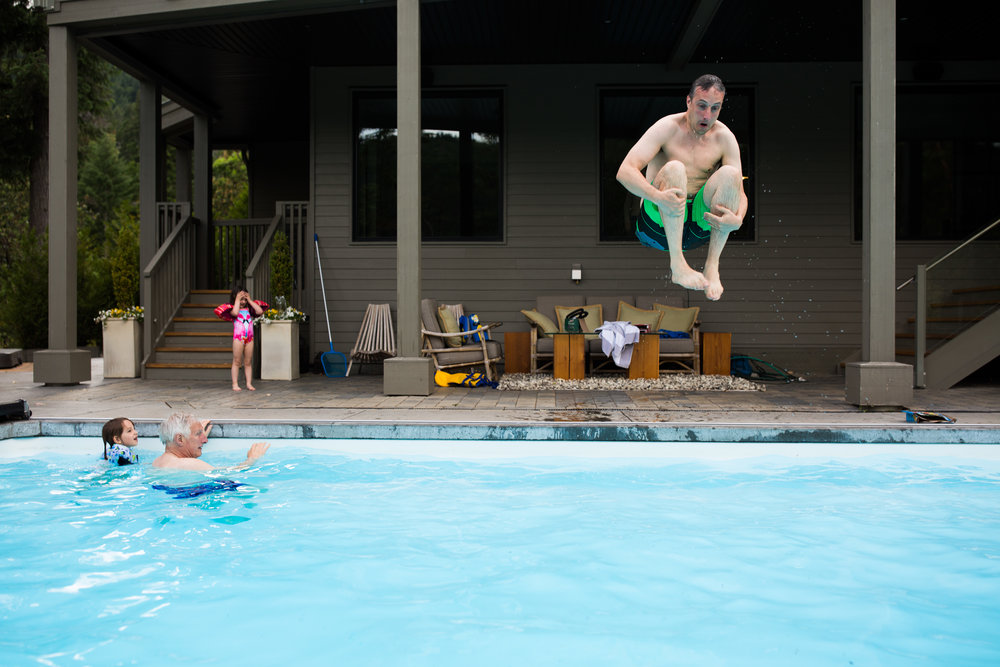 Dad doing cannon bomb into swimming pool