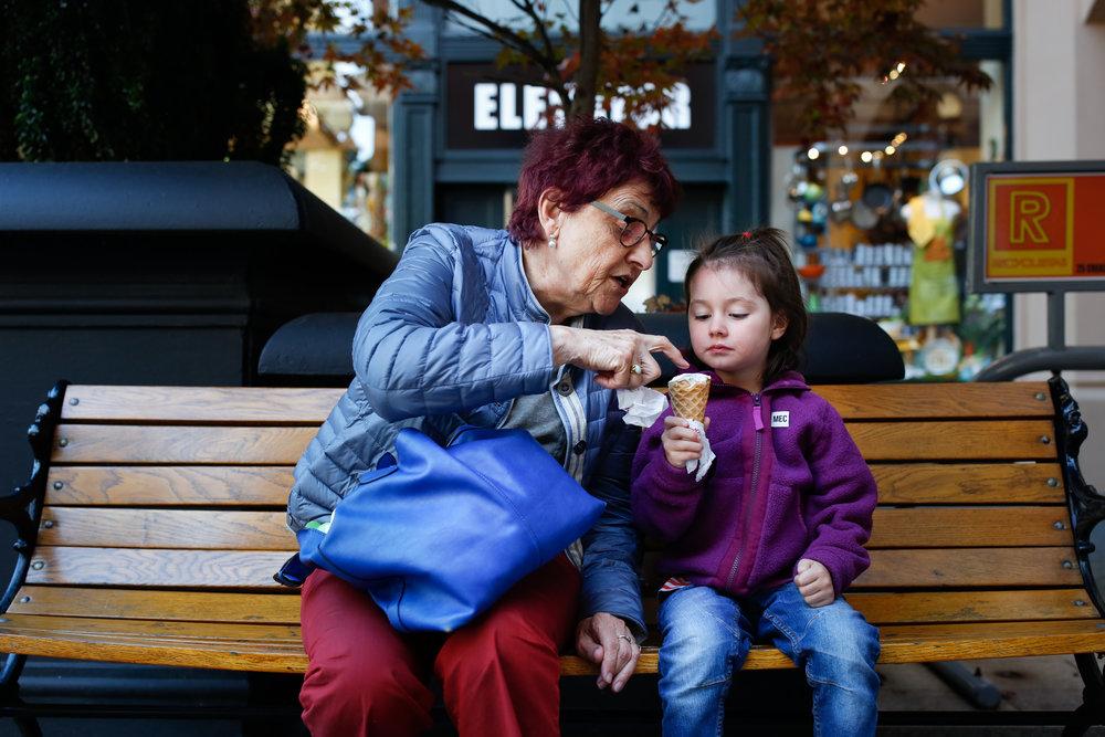 grandma and granddaughter enjoying ice cream