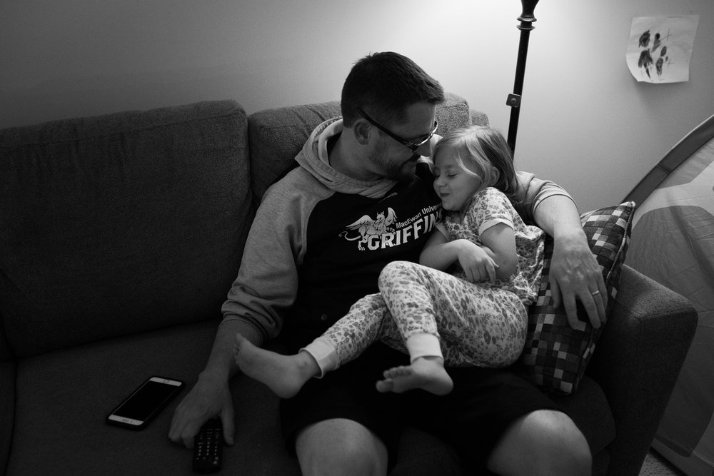 dad cuddling daughter