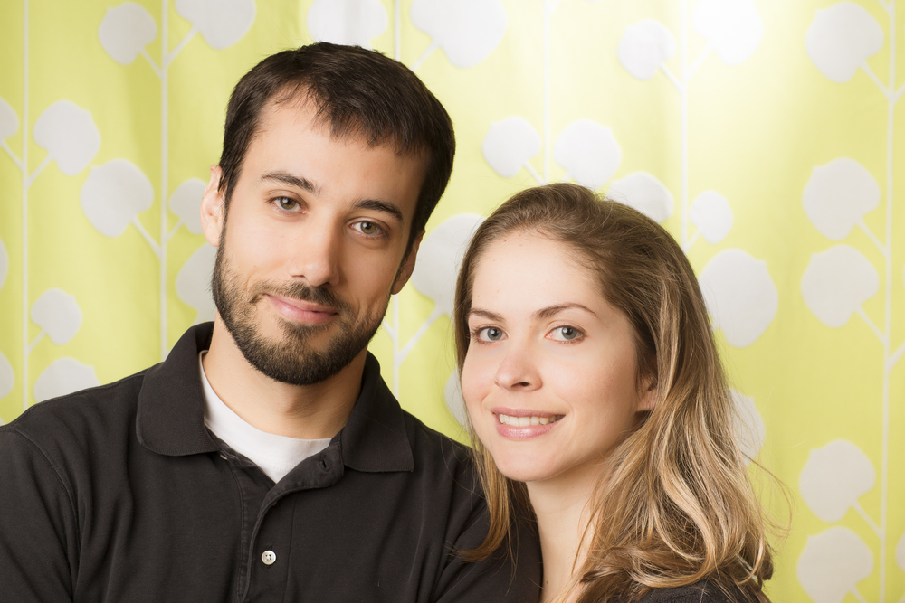 14 young couple family portrait studio session on green background.jpg