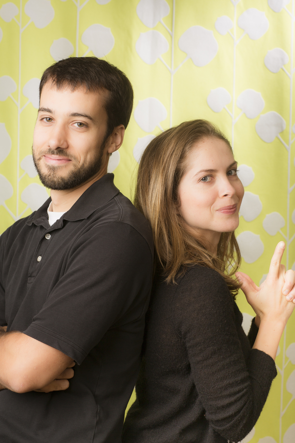 28 young couple family portrait studio session on fun green background.jpg