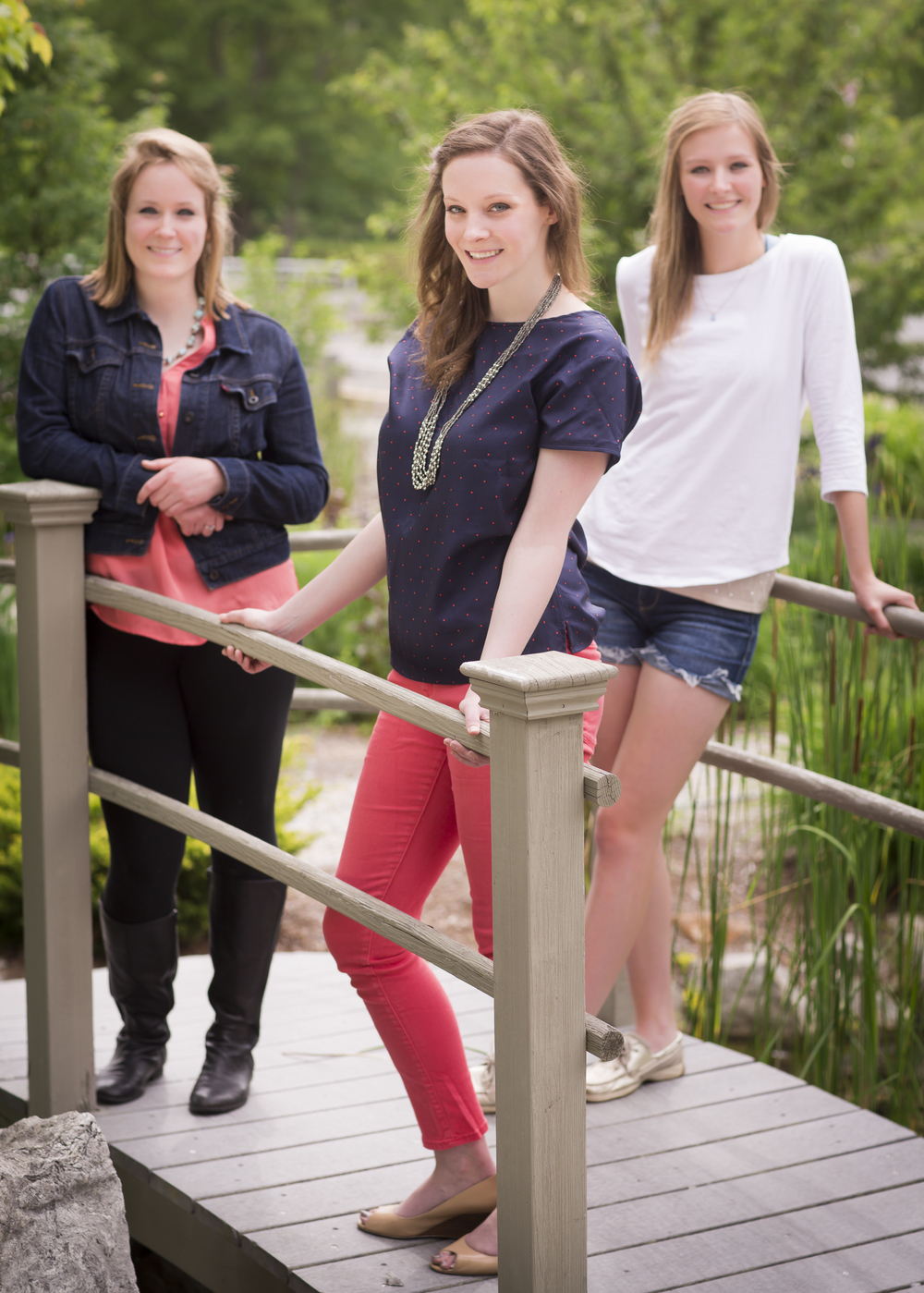 05 3 sisters family portrait outdoor session on bridge.jpg