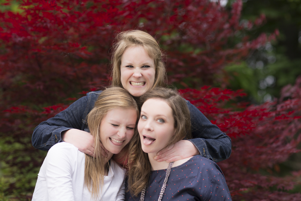 11 3 sisters family portrait outdoor session being very silly maple tree.jpg