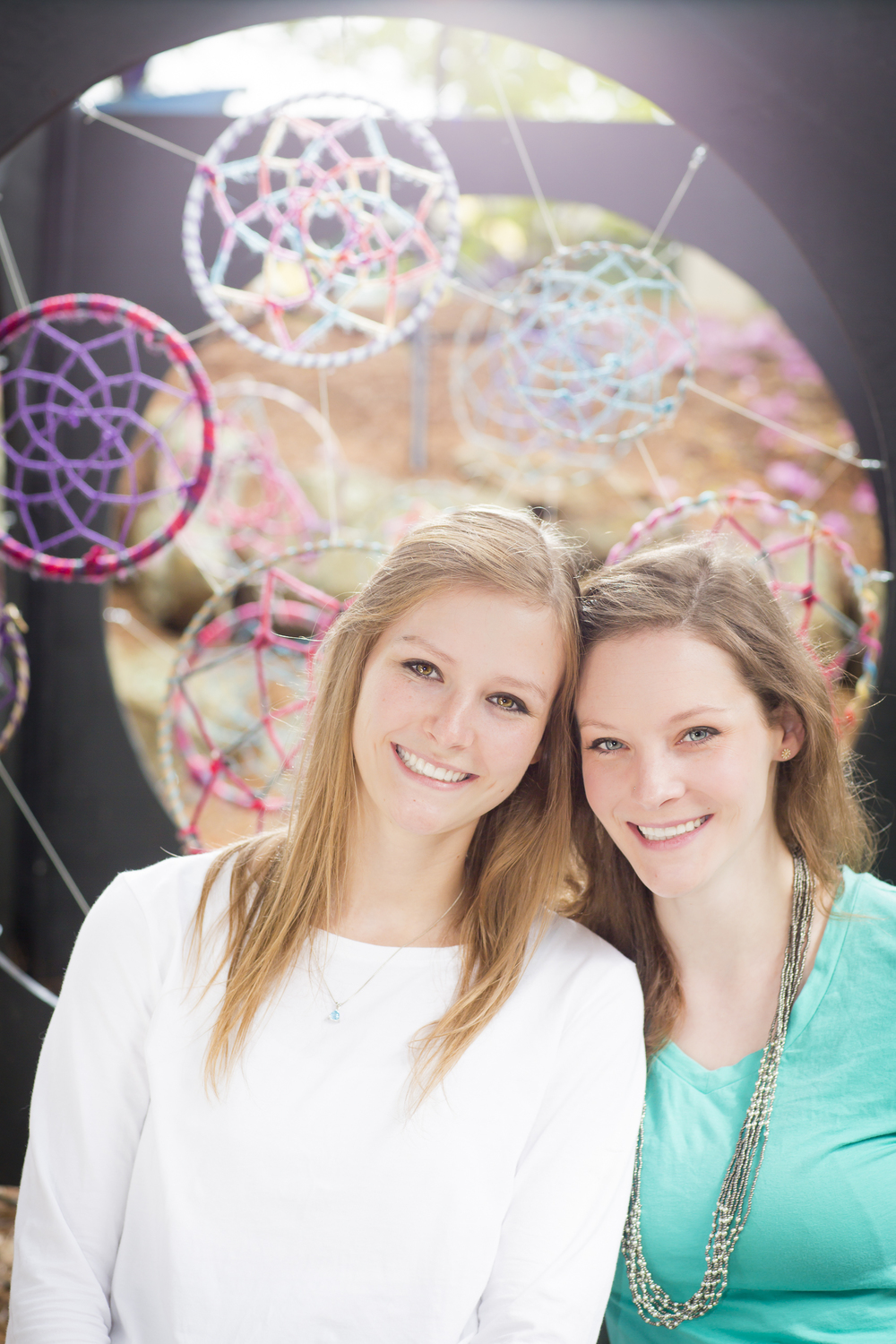 19 2 sisters family portrait outdoor session vibrant dream catchers.jpg