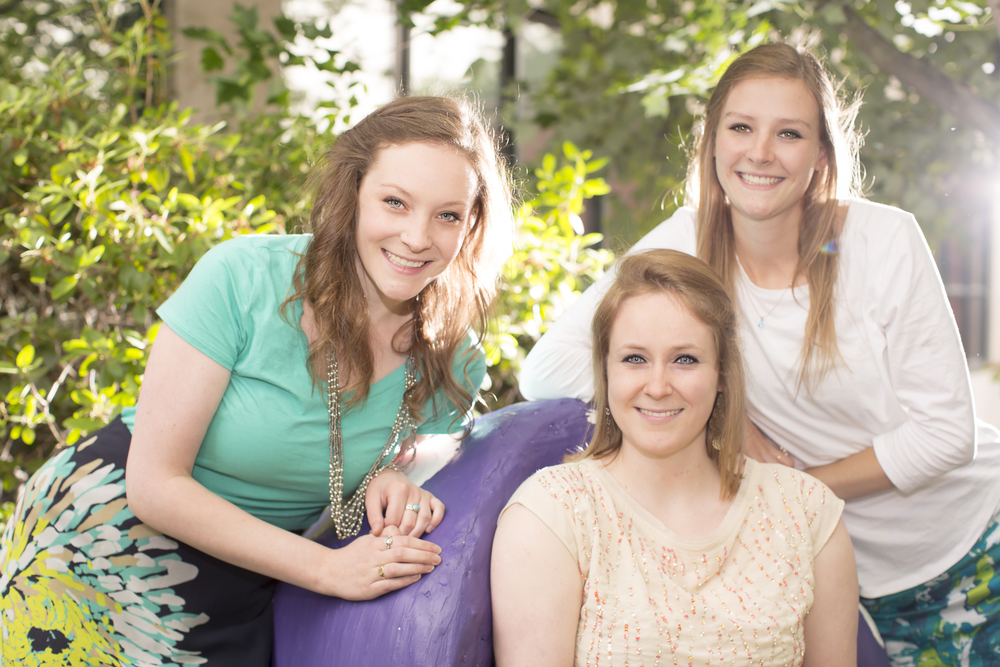 21 3 sisters family portrait outdoor session vibrant mushroom chair.jpg