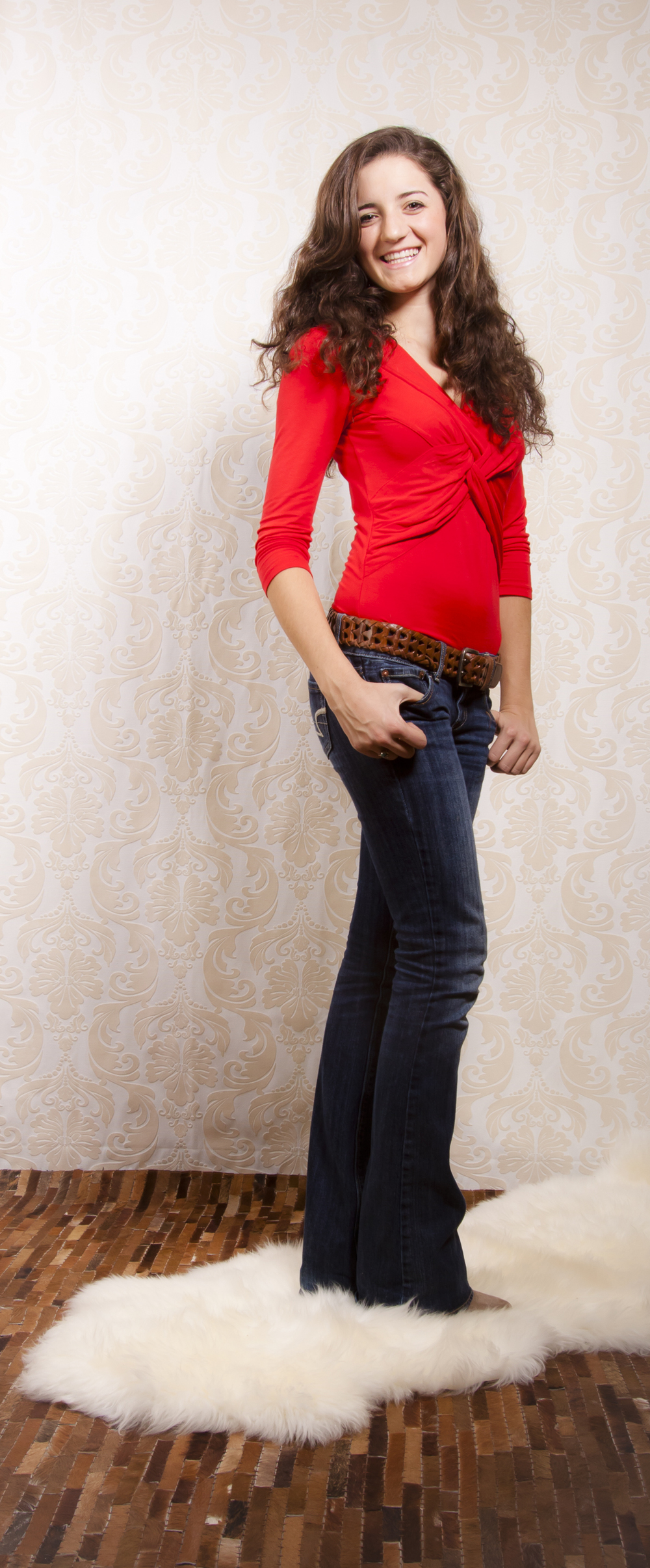 05 modern western styled senior portrait session bright red shirt leather rug 8739.jpg
