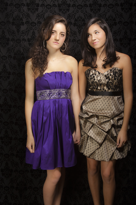 modern styled family portrait session prom dress sisters on black background.jpg