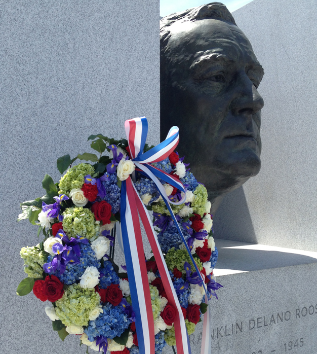 The Memorial Day wreath of roses, carnations, hydrangea and irises was placed at President Roosevelt's portrait-head.