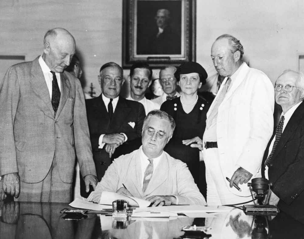 Secretary of Labor Frances Perkins, the only woman present as Roosevelt signed the Social Security Act in 1935. LOC