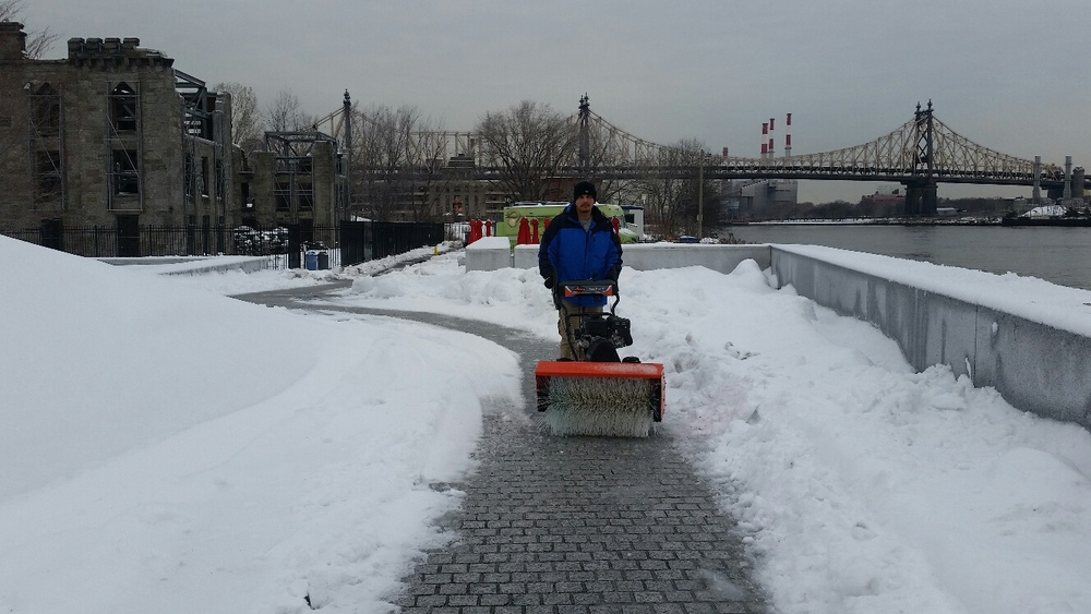 Park staff clearing walkways for visitors.