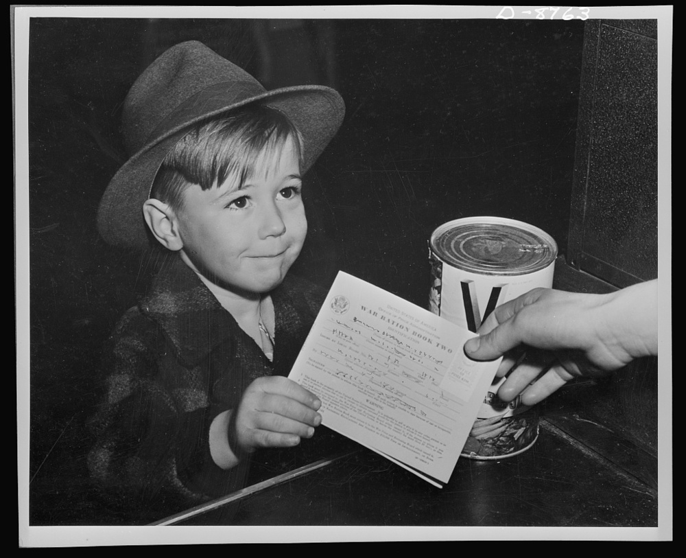 An eager school boy gets his first experience in using war ration book two. Library of Congress