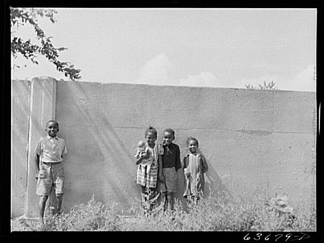 Children standing in front of half mile concrete wall, Detroit, Michigan
