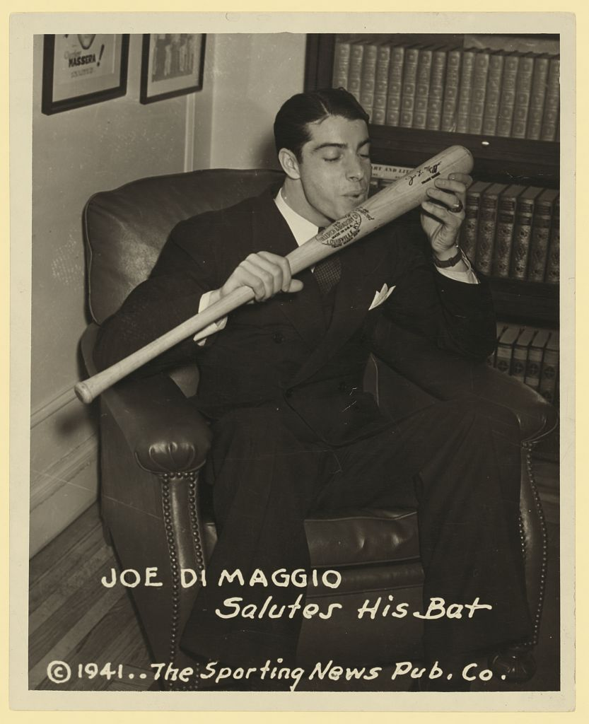 Joe DiMaggio salutes his bat