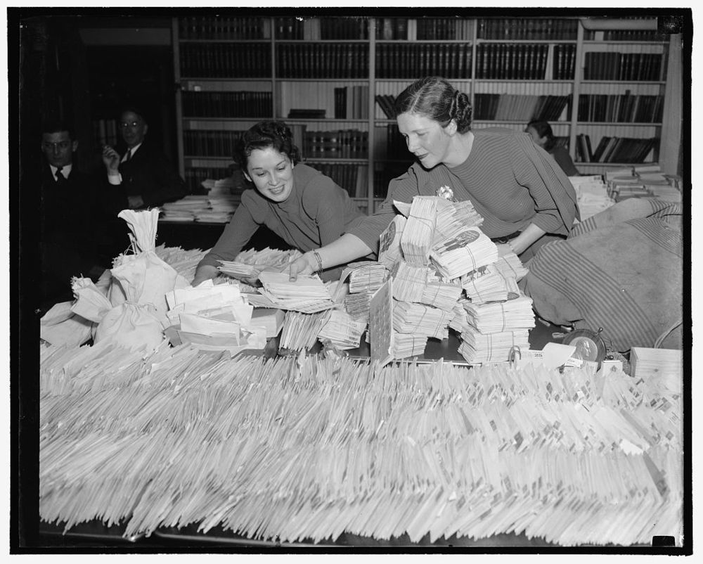 Barbara Councilor and Ethel Haberkorn, Workers in the White House Mail Room, attempting to keep up with the flood of dimes which are coming to the President's Birthday Ball Committee to add to the fund to right infantile paralysis. Courtesy, LOC