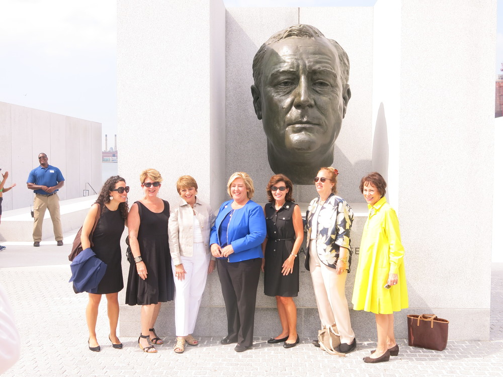 From left to right:  Lauren Racusin of Empire State Development, Susan Rosenthal of RIOC, Sally Minard of Four Freedoms Park Conservancy, Assembly Member Rebecca Seawright, Lt. Governor Kathy Hochul, Borough President Gale Brewer, and Barbara Shattuck Kohn of Four Freedoms Park Conservancy