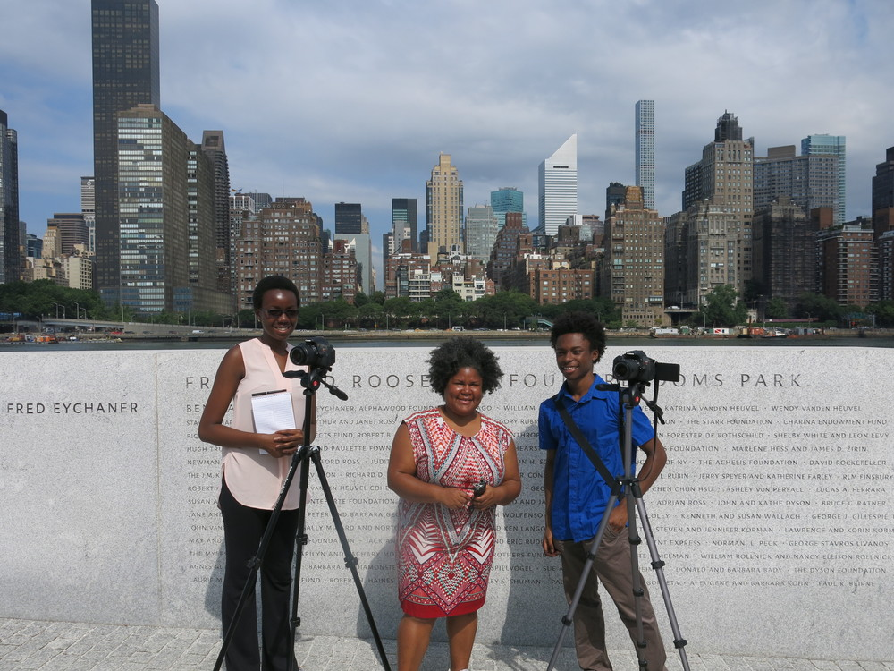 Youth Documentarian Program: Documentary film-maker Katherine Cheairs (center) is working with Marie-Therese Ghunney (left) and Isaiah Lee (right) on a project to document the stories of older Americans who lived during the FDR administration.