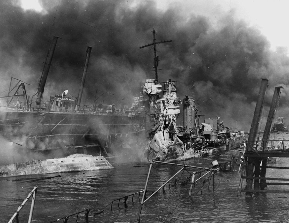 The twisted remains of the destroyer USS Shaw, destroyed in a floating dry dock at Pearl Harbor by Japanese bombers, December 7, 1941. The ship's forward ammunition magazines had ignited in a tremendous explosion, but the ship was later repaired and would serve throughout the war. National Archives