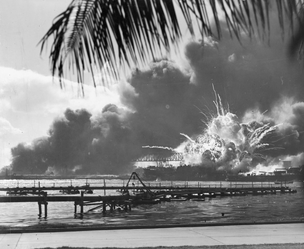 The USS Shaw explodes under Japanese attack the morning of December 7, 1941, in the waters of Pearl Harbor.