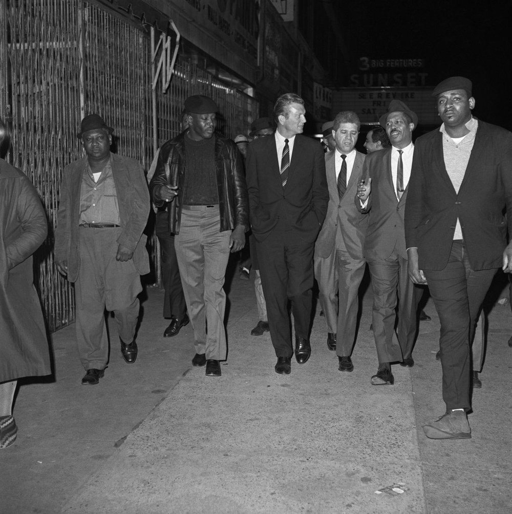 Mayor Lindsay walks through Harlem on the night of King's assassination.