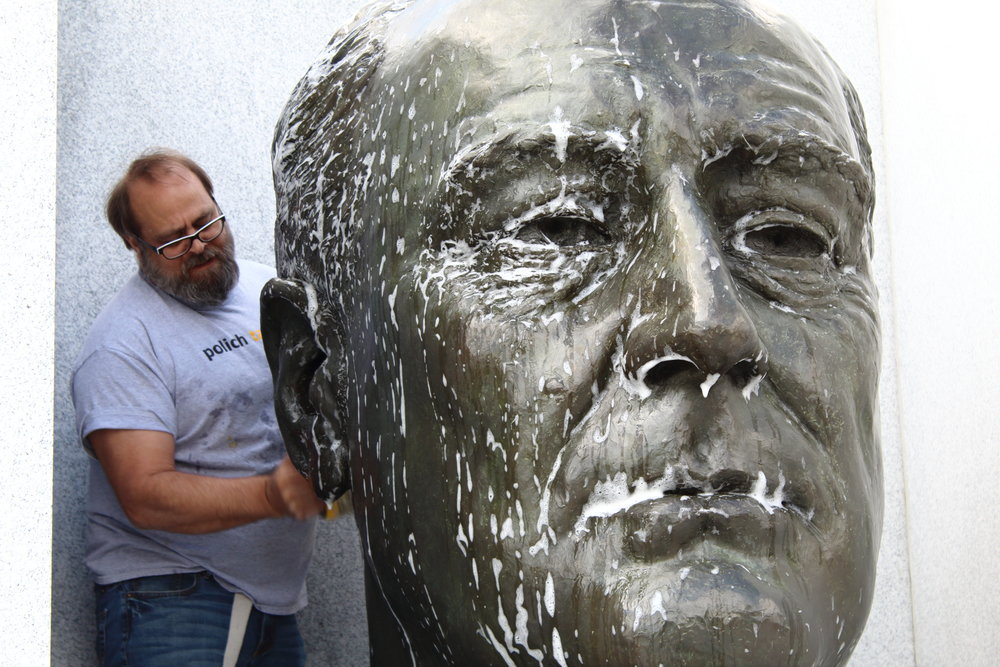 Pollich Tallix cleans the bust with regular detergent and water. Photo by Michael Heck, Four Freedoms Park Conservancy.