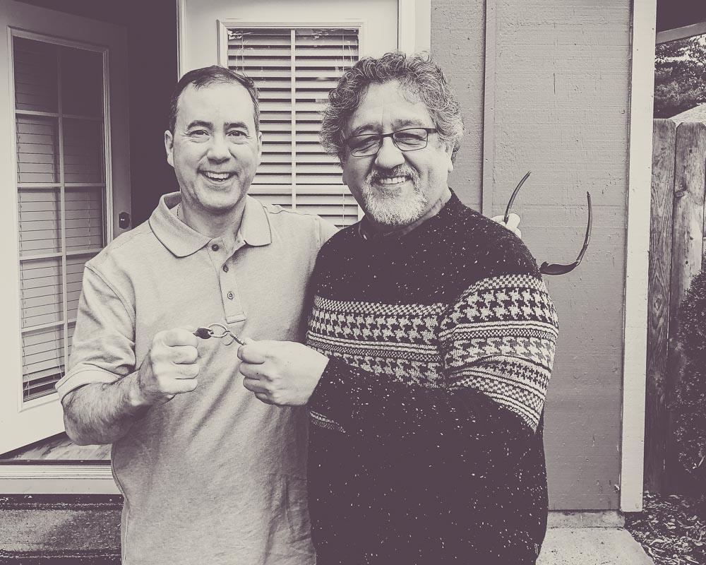 Bilingual Realtor® Francisco Salgado, with Portland Digs, in Portland, Oregon with new home buyer.