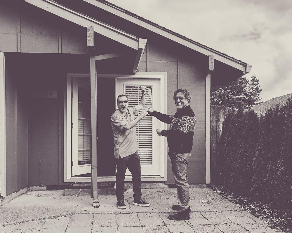 Bilingual Realtor® Francisco Salgado in Portland, Oregon with new home buyer.