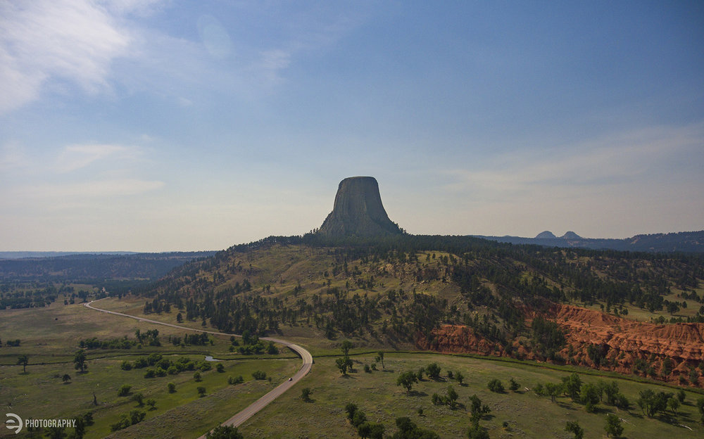 An aerial drone photo taken from the Devils Tower KOA parking lot. The red rock on the right is on the outskirts of the Red Bed Trail I mentioned above. Worth the walk!  The haze is due to the wildfires blazing near the south entrance to Yellowstone National Park.