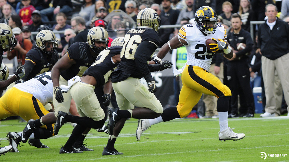 Akrum Wadley runs past a slew of Purdue defenders for Iowa's first of many touchdowns.