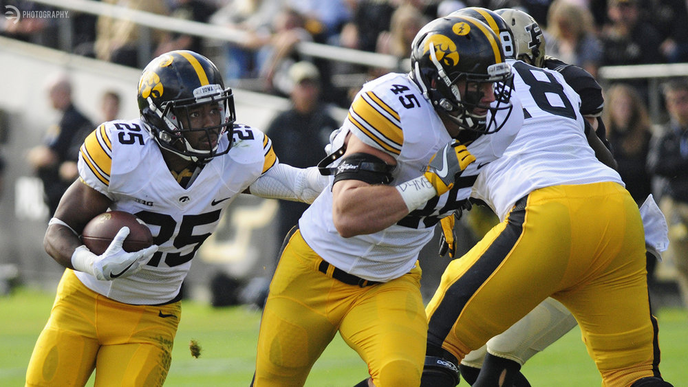 Akrum Wadley gets a beautiful lead block from Drake Kulick for another Iowa first down.