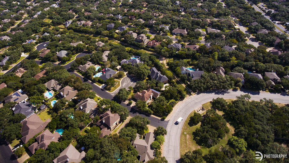 An aerial drone shot of a San Antonio suburban neighborhood. I liked the way the road curved around and the FedEx truck drove right into the shot.