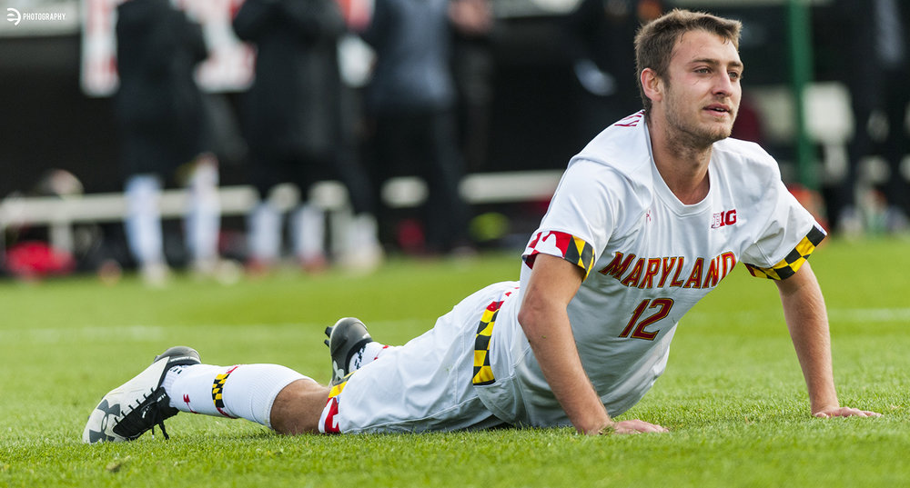 Soccer players seem to spend an inordinate amount of time laying in the grass.