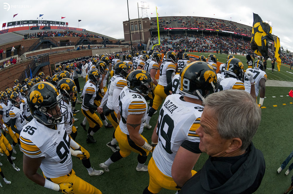 Iowa Hawkeyes Head Coach Kirk Ferentz watches as the team swarms onto the field in Champaign, IL to take on Illinois in B1G play on Saturday, Nov. 19.