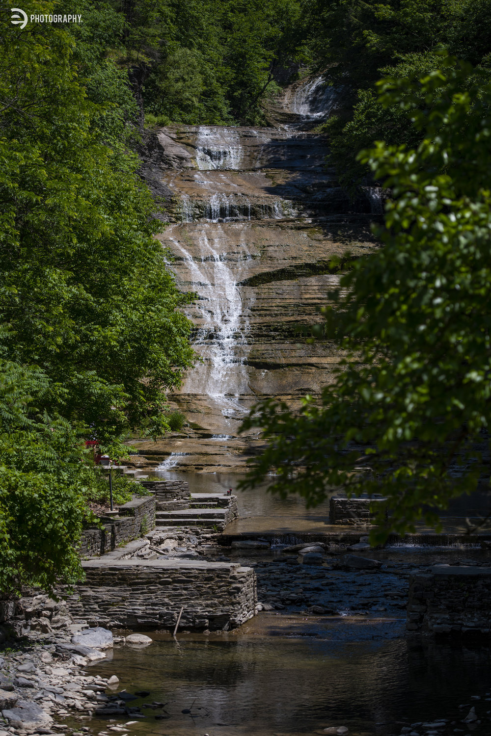The view of Buttermilk Falls from the footbridge that leads to the gorge trail.