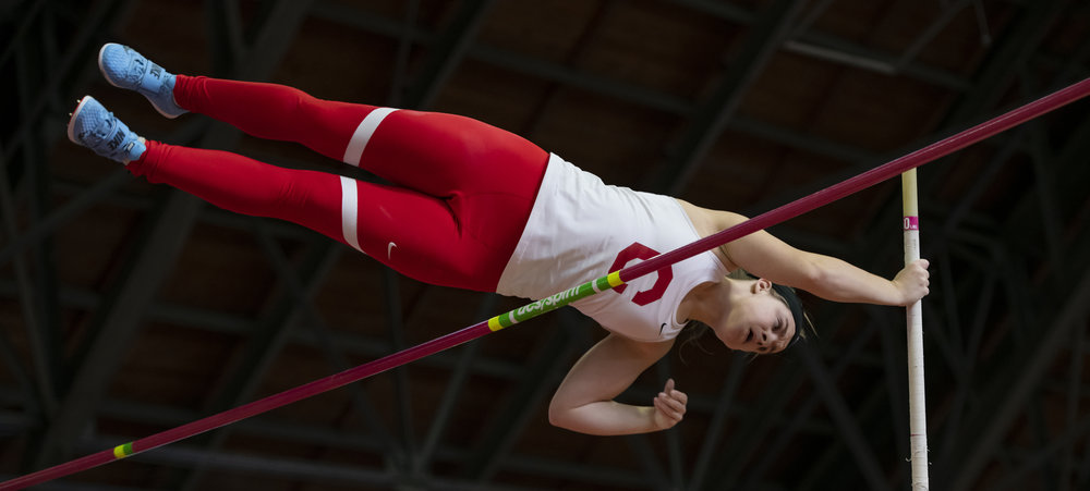 The dark ceiling of Barton Hall makes a great contrast against our bright red and white uniforms, especially in the pole vault.