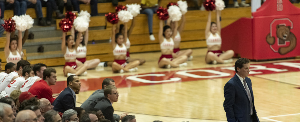 I really like this quiet shot of head coach Brian Earl, complete with our primary logo, a row of cheerleaders and the bench, all watching in anticipation.