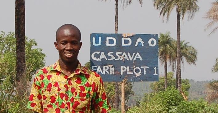 man by cassava sign.jpg