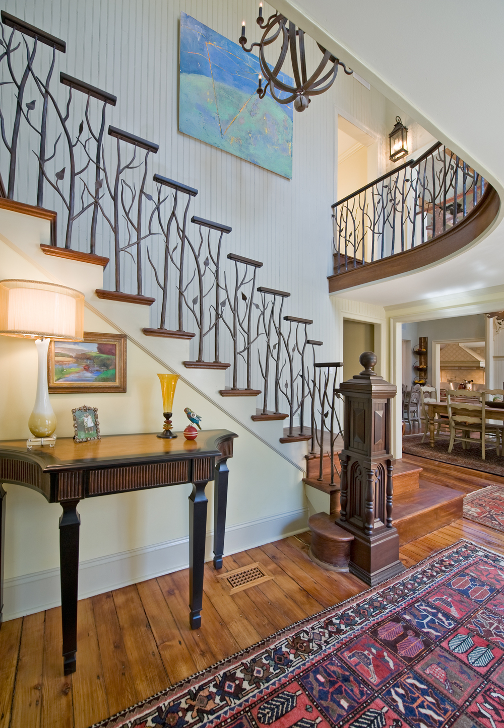 miho created an earthy design of iron branches executed by artesano iron works the banisters are finished with handscraped mahogany rails