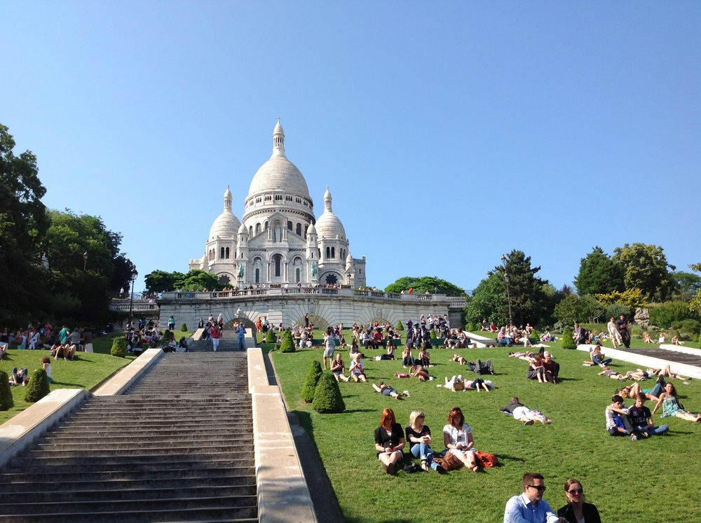 Lounging on the slopes below Sacré-Cœur on a fine summer day.