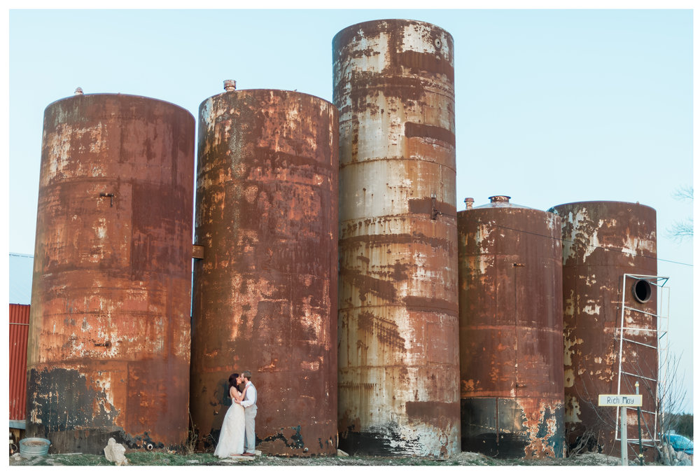 Photos under rustic silos at Apple Holler