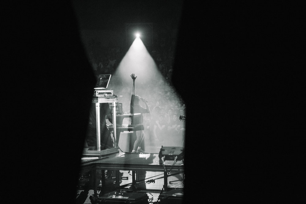 An image shot from backstage of Logic performing in Mesa, AZ