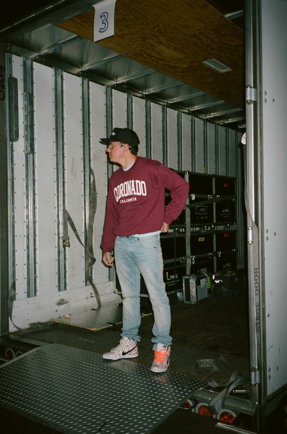 Logic hiding from fans seconds before going on stage in Chicago.