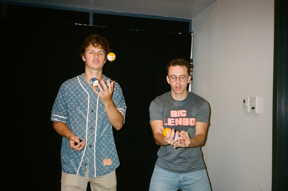 Ansel Elgort and Bob try and juggle pool balls.
